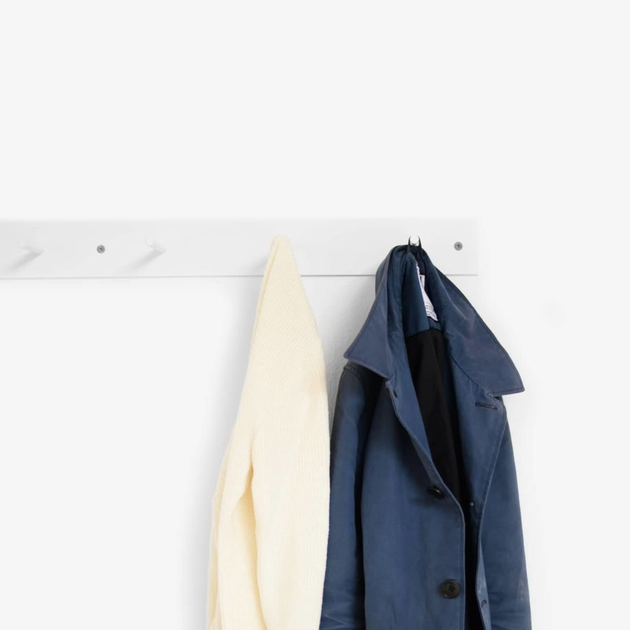 Hellogoodbye coat rack is made of a flat piece of steel white powder coated plus six round hooks with notches to prevent clothes or coat hangers from sliding off.
