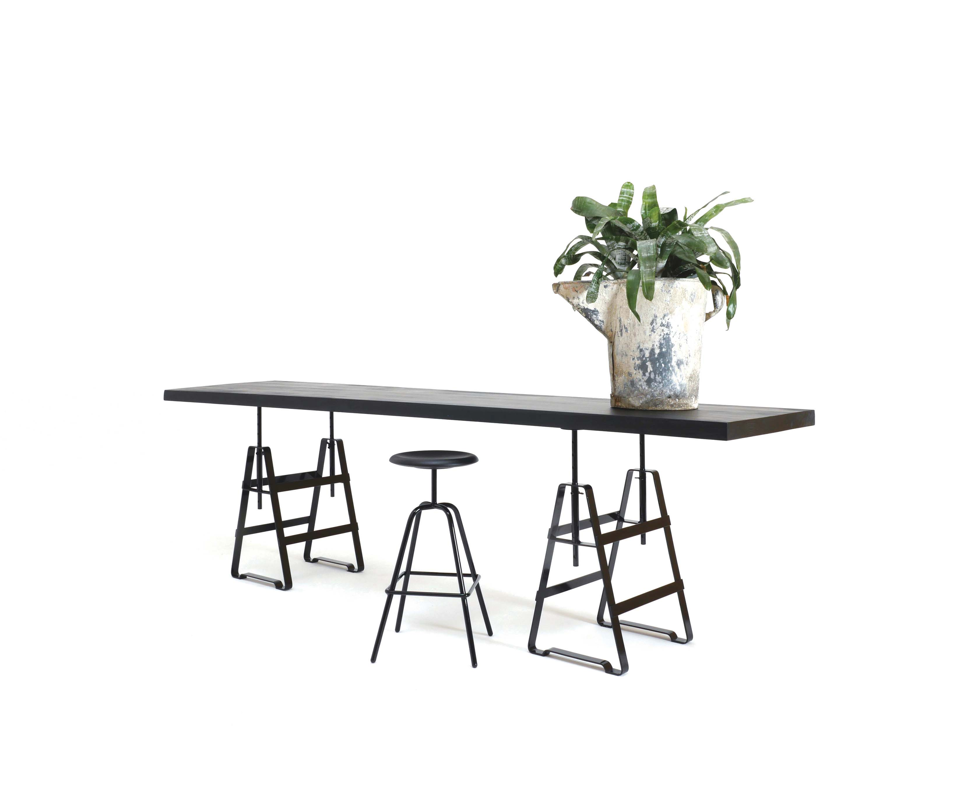A height adjustable trestle made from oiled crude steel. It is applicable with several shelves and slabs. The same variable as Affe but powder-coated plays Lackaffe with the image of solid steel furniture.Table top from Zascho Petkow for ABC New York